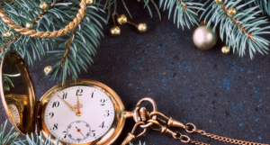 pocket watch next to christmas tree