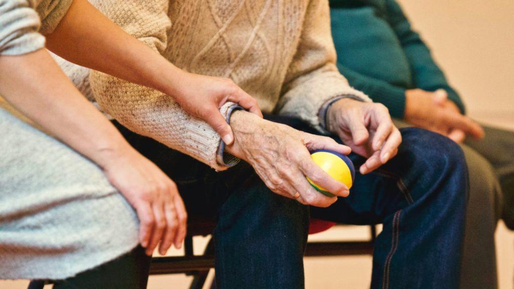holding elderly mans arm