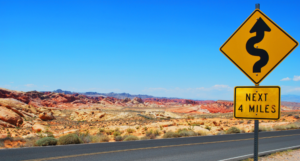 curvy roads next 4 miles sign